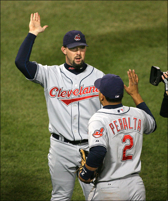 Game Two at Fenway Park. Cleveland's Trot Nixon receives congratulations from Jhonny Peralta after his game-winning hit against the Red Sox.