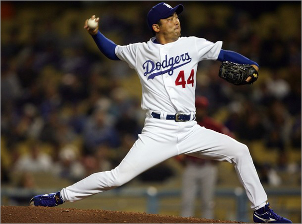 Takashi Saito of the Los Angeles Dodgers pitches against the Arizona Diamondbacks during the ninth inning on May 1, 2007 at Dodger Stadium in Los Angeles,