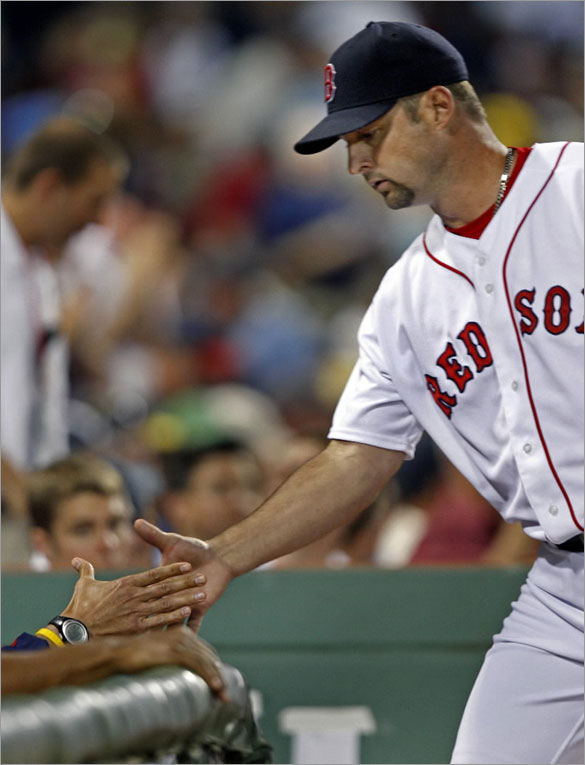 Tim Wakefield gets a hand for a job well done as he comes into the dugout following the seventh inning , which would be his last frame of the evening.