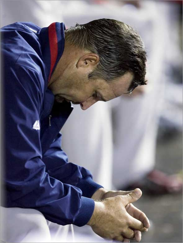 Red Sox starting pitcher Tim Wakefield hangs his head in the dugout after leaving the game in the fifth inning after giving up seven runs against the Los Angeles Angels during a baseball game in Anaheim, Calif., Wednesday, May 13, 2009.