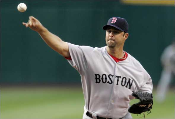 Red Sox's Tim Wakefield pitches to the Cleveland Indians in the first inning of a baseball game, Monday, April 27, 2009, in Cleveland.
