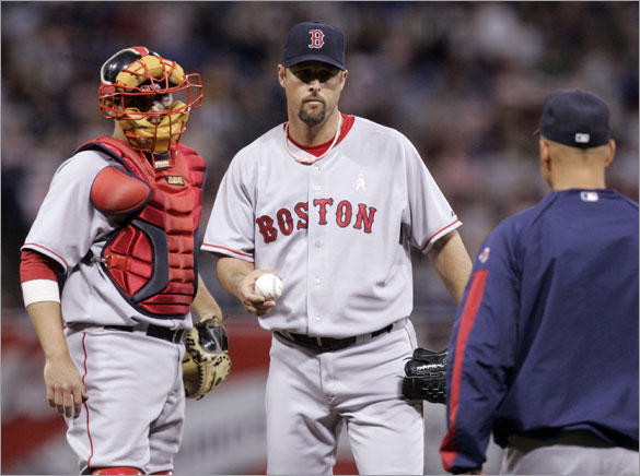 Red Sox pitcher Tim Wakefield gives up the ball to manager Terry Francona, right, after giving up the seventh run to the Minnesota Twins in third  inning of a baseball game Sunday,  May 11, 2008 in Minneapolis. At left is catcher Kevin Cash.