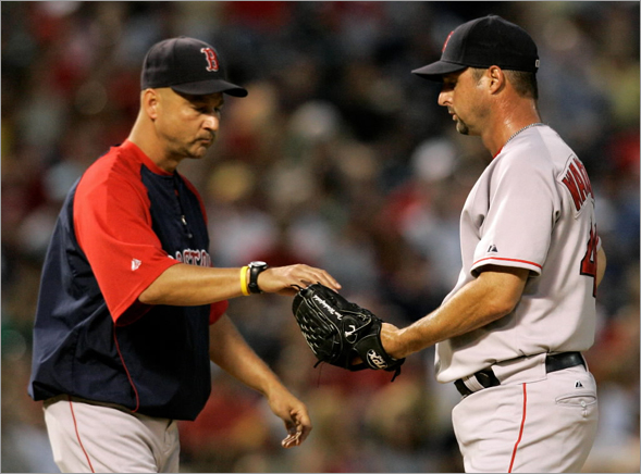 Red Sox relief Tim Wakefield, right, is pulled from the game by manager Terry Francona in the second inning of a Major League Baseball game against the Texas Rangers, Saturday, Sept. 6, 2008, in Arlington, Texas.