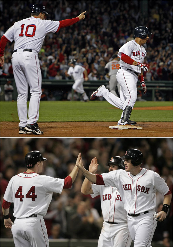 Jason Bay, left, celebrates with teammates Brian Anderson, right, and Kevin Youkilis after all three scored on a three-run double by Red Sox's Victor Martinez in the seventh inning
