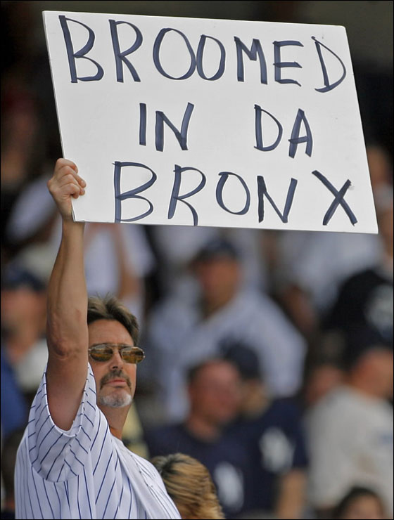 A Yankee fan holds up a sign in the ninth inning indicating what is about to happen, as New York took its third straight game from the Red Sox.