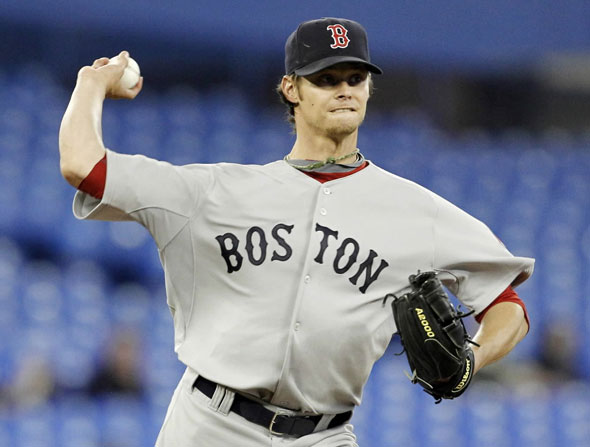 Red Sox pitcher Clay Buchholz throws to first against the Toronto Blue Jays during the first inning of their MLB American League baseball game in Toronto April 27, 2010