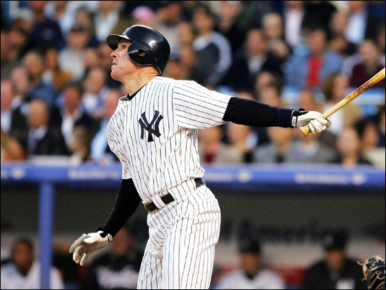 John Flaherty No. 17 of the New York Yankees hits a single to score Alex Rodriguez No. 13, cutting the Seattle Mariners lead to 2-1 in the second inning at Yankee Stadium on May 10, 2005 in Bronx, New York.