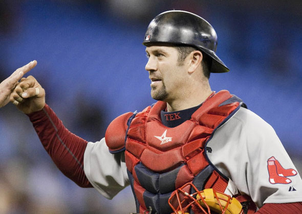Red Sox catcher Jason Varitek is congratulated by teammates after defeating the Toronto Blue Jays 13-12 in a baseball game in Toronto on Monday April 26, 2009.