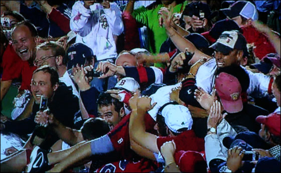 Lowell and Cora dive into the crowd during the celebration