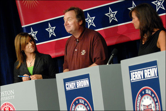Tina Cervasio and Tim Russert, center, moderate a discussion among the candidates for the President of Red Sox Nation, as candidates Rob Crawford, left, and Cindy Brown, right, look on at Boston University on Thursday