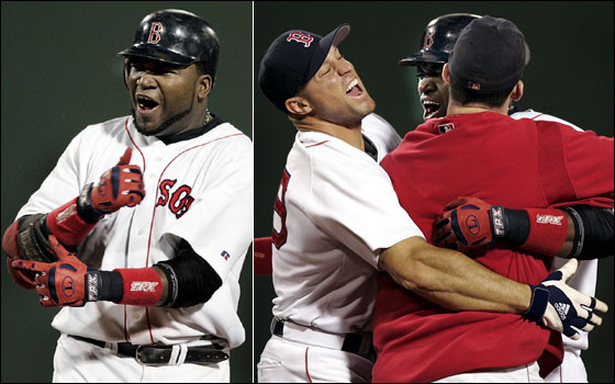 David Ortiz is mobbed by teammates Gabe Kapler and Trot Nixon following his game winning hit in the bottom of the 14th inning that gave Boston a 5-4 victory.