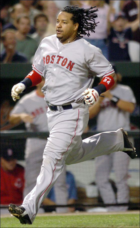 Manny Ramirez races home to score on a double by Trot Nixon in the fifth inning Friday, Sept. 23, 2005, in Baltimore.