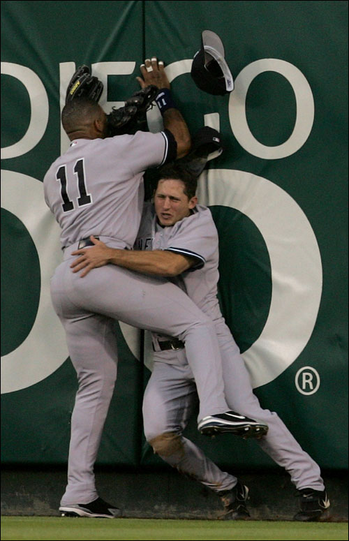 New York Yankees outfielders Gary Sheffield (11) and Bubba Crosby collide against the centerfield wall chasing a two-run triple hit by the Los Angeles Angels' Adam Kennedy in the second inning of Game 5 of their American League Division Series in Anaheim, Calif., Monday, Oct. 10, 2005.