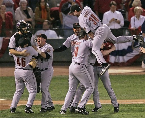 Houston Astros Luke Scott (30) leaps on top of his teammates as they celebrate their 5-1 victory over the St. Louis Cardinals in Game 6 to win the National League Championship pennant in St. Louis, Wednesday, Oct. 19, 2005.