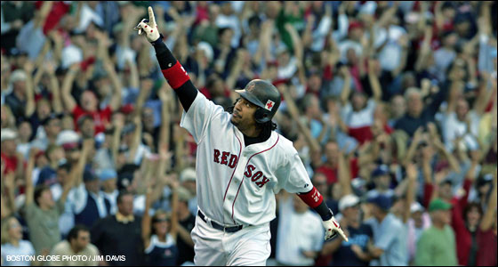 Manny Ramirez points skyward as the fans go wild as he begins his home run trot following his fourth inning three run home run.