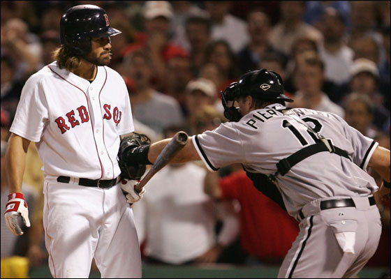 Catcher A.J. Pierzynski of the Chicago White Sox tags out Johnny Damon of the Red Sox after striking out to the end the inning with the bases loaded during Game Three of the American League Division Series at Fenway Park on October 7, 2005 in Boston, Massachusetts.
