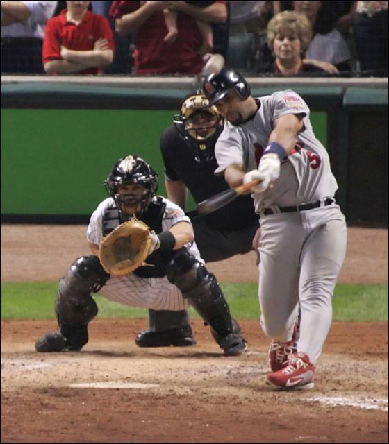 St. Louis Cardinals' Albert Pujols and Houston Astros closer Brad Lidge watch Pujol's three-run homer in the ninth inning to give the Cardinals a 5-4 win in Game 5 of the National League Championship Series Monday, Oct. 17, 2005, in Houston.