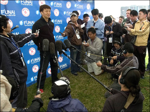 Boston Red Sox lefthanded pitcher Hideki Okajima of Japan talks to members of the media at the team's Player Development Complex in Fort Myers, Florida February 15, 2007. Pitchers and catchers report to spring training camp February 16 and have their first workout the next day.