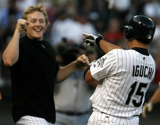 Chicago White Sox Tadahito Iguchi is cheered by teammate Brian Anderson after Iguchi hit the game winning RBI single against the Boston Red Sox in the 19th inning of a baseball game Sunday, July 9, 2006, in Chicago. The White Sox defeated the Red Sox 6-5.