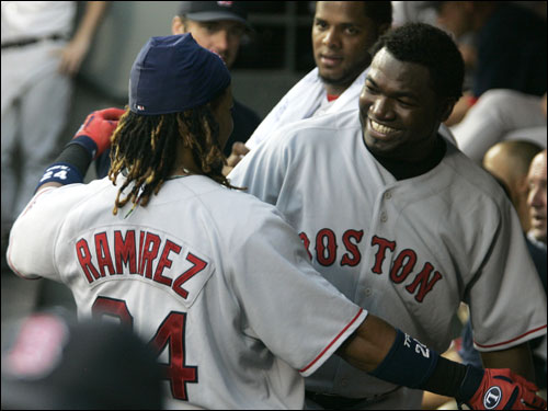 Manny Ramirez hugged teammate David Ortiz after Ramirez hit a home run that also scored Ortiz in the fifth inning.