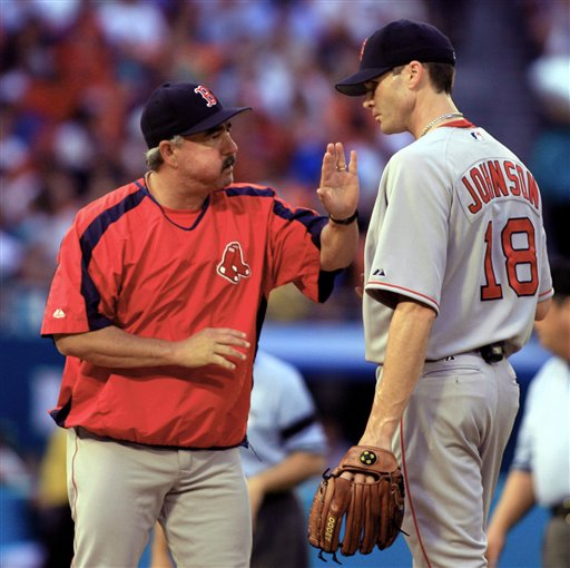 Red Sox bullpen coach Al Nipper talks to pitcher Jason Johnson (18) in the first inning of a interleague baseball game against the Florida Marlins on Friday, June 30, 2006, at Dolphin Stadium in Miami.