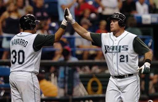 Tampa Bay Devil Rays' Dioner Navarro congratulates Ty Wiggington after Wiggington's solo home run off Boston Red Sox starter Curt Schilling during the seventh inning of a baseball game Tuesday, July 4, 2006, at Tropicana Field in St. Petersburg, Fla.