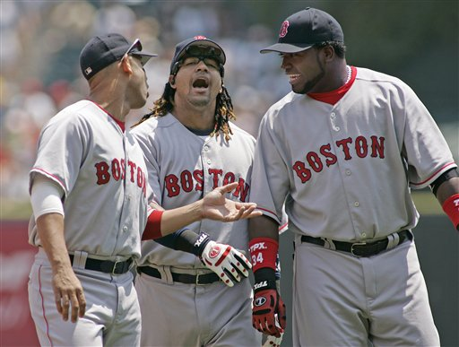Red Sox' Alex Cora, Manny Ramirez and David Ortiz, from left, joke around while warming up before a baseball game against the Chicago White Sox in Chicago, Saturday, July 8, 2006.