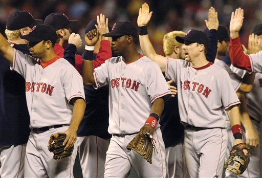 Edgar Renteria, center, celebrates with teammates after they beat the Baltimore Orioles, 4-3, Saturday, Sept. 24, 2005, in Baltimore. Renteria hit a two-run single in the top of the ninth to break a 2-2 tie.