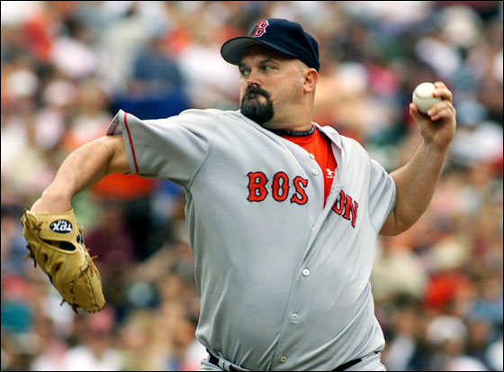 Red Sox starting pitcher David Wells delivers a pitch against the Baltimore Orioles in the third inning of their American League baseball game at Camden Yards in Baltimore, Maryland September 25, 2005. Wells pitched six and two-thirds innings, giving up three runs on six hits before being taken out of the game by manager Terry Francona.