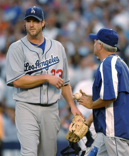 Los Angeles Dodgers pitcher Derek Lowe leaves the game after handing the ball to manager Grady Little, right, in the sixth inning of Game 1 of the National League Division Series against the New York Mets at Shea Stadium in New York on Wednesday, Oct. 4, 2006. The Mets won 6-5.