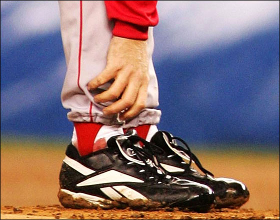 Pitcher Curt Schilling of the Red Sox grabs at his ankle as it appears to be bleeding in the fourth inning during game six of the American League Championship Series against the New York Yankees on October 19, 2004 at Yankee Stadium in the Bronx borough of New York City.