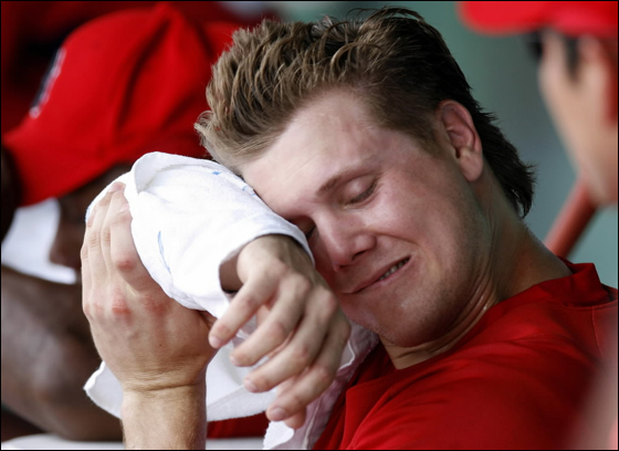 Jonathan Papelbon No. 58 of the Boston Red Sox wipes the sweat from his forehead between innings against the Philadelphia Phillies during a Spring Training game at City of Palms Park March 3, 2007 in Ft. Myers, Florida. Philadelphia won the game 12-9.