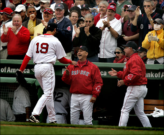 Red Sox manager Terry Francona, center, congratulates starting pitcher Josh Beckett after completing the seventh inning against the Toronto Blue Jays on Opening Day at Fenway Park in Boston, Tuesday April 11, 2006. Beckett gave up one run on three hits in his seven inning outing.  At right is interim pitching coach Al Nipper.