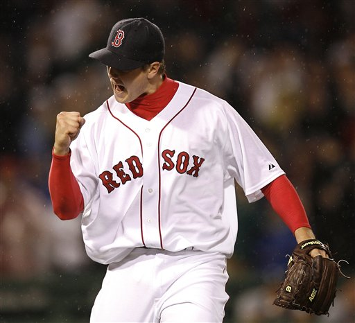 Boston Red Sox pitcher Jonathon Papelbon pumps his fist after the final out of the Red Sox' 2-1 win over the Seattle Mariners in MLB baseball at Fenway Park in Boston, Friday