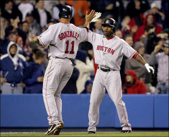 Willie Harris and Alex Gonzalez of the Red Sox celebrated after both scored in the seventh inning against the New York Yankees at Yankee Stadium on May 11, 2006