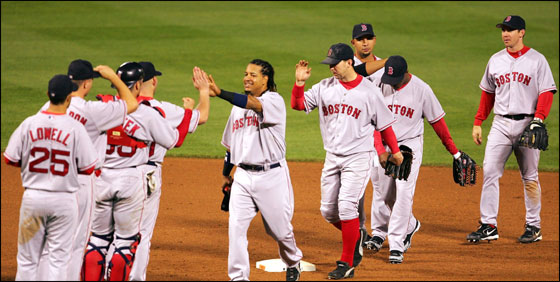 The Red Sox congratulate each other after defeating the Baltimore Orioles 6-5 on May 16, 2006 at Camden Yards