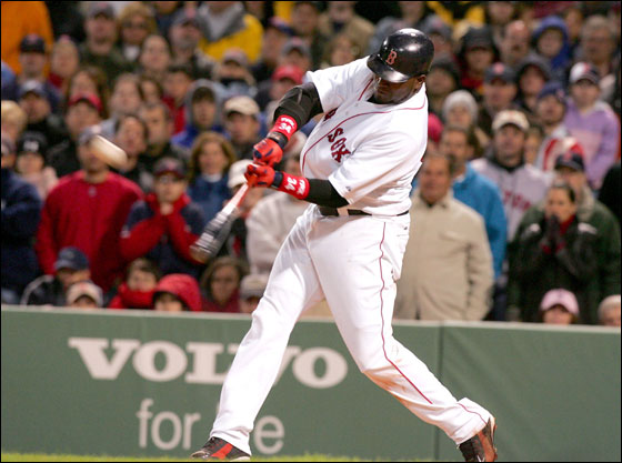 David Ortiz of the Boston Red Sox hits a three run home run in the eighth inning against the New York Yankees at Fenway Park on May 1, 2006 in Boston, Massachusetts.