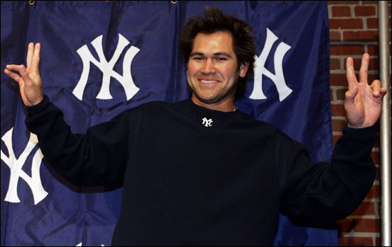 Current New York Yankees outfielder and former Boston Red Sox player, Johnny Damon, gestures to the media after a pre-game news conference in Boston, Monday, May 1, 2006 prior to his first time taking the field at Fenway Park in a Yankees' uniform.