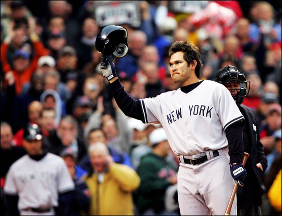 Johnny Damon of the New York Yankees acknowledges the crowd before his first at-bat against his former team, the Boston Red Sox, at Fenway Park May 1, 2006 in Boston, Massachusetts.