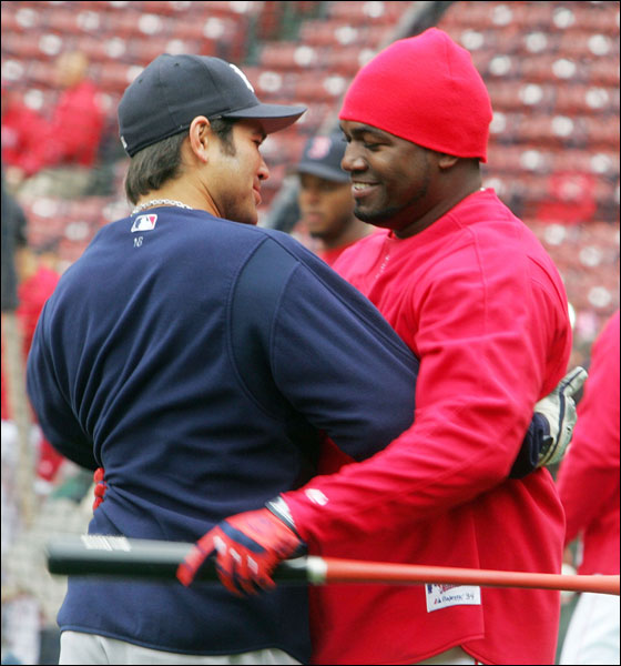 David Ortiz of the Boston Red Sox (R) greets former teammate Johnny Damon of the New York Yankees (L) before their game at Fenway Park May 1, 2006 in Boston, Massachusetts.