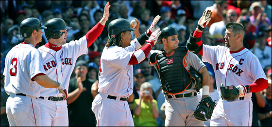 Orioles catcher Ramon Hernandez throws the new ball he just got from home plate umpire C.B. Bucknor (not pictured), because Red Sox catcher Jason Varitek (right) had just hit the last one over the fence for a first inning grand slam. Varitek is greeted by the three teammates who scored ahead of him on the blast, (left to right) Mark Loretta, Trot Nixon and Manny Ramirez.