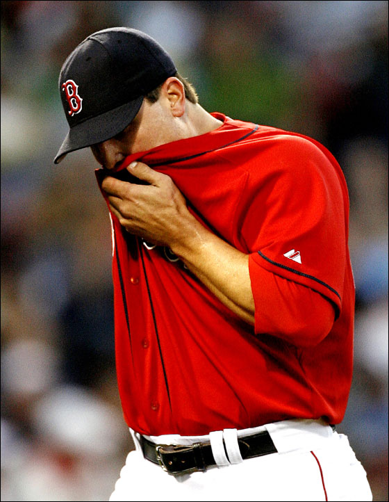 Red Sox pitcher Keith Foulke leaves the mound after the eighth inning of Game 2 of a doubleheader against the Texas Rangers in major league baseball action at Fenway Park in Boston Sunday, June 11, 2006. Foulke gave up four runs and seven hits over two innings.