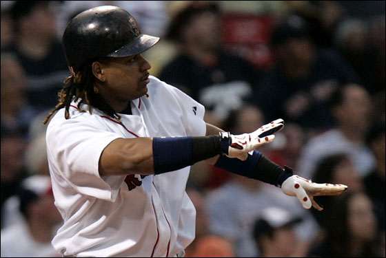 Boston Red Sox vs. Philadelphia Phillies-Game 1 -  Manny Ramirez watches the flight of his 3 run HR in the 1st inning.