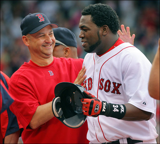 David Ortiz delivered yet another victory to the home team, as his single in the bottom of the 12th inning gave the Sox an 8-7 win over the Philadelphia Phillies at Fenway Park. Here manager Terry Francona can't keep the huge grin off his face as he congratulates Ortiz following the hit.
