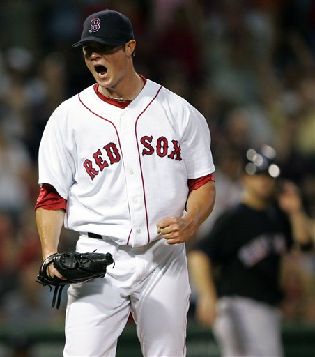 Red Sox pitcher Jon Lester yells after New York Mets' Chris Woodward struck out swinging to end the fourth inning of a baseball game, Tuesday, June 27, 2006, in Boston.
