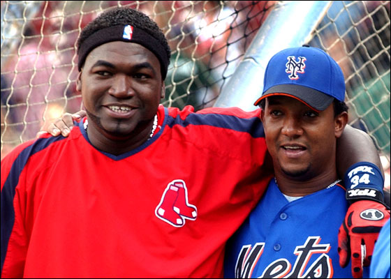 Red Sox's David Ortiz, left, and New York Mets' Pedro Martinez chat before the start of a major league baseball game Tuesday, June 27, 2006 in  Boston. This was the first game at Fenway Park for Martinez who left the Red Sox for the Mets last season.