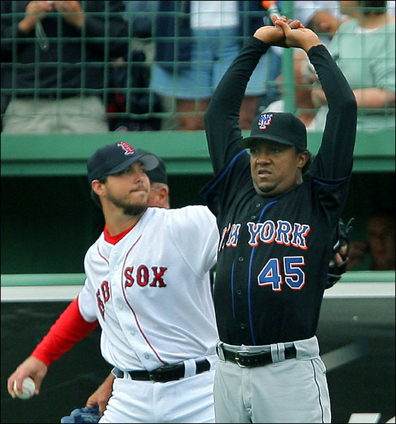 Pedro stretches out near Josh Beckett prior to his short stint at Fenway