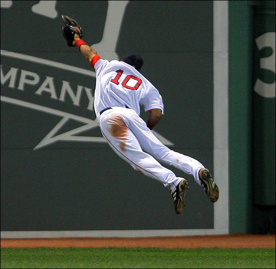 Red Sox CF Coco Crisp makes a great leaping catch to rob the Mets David Wright to end the eighth inning and preserve the Boston lead.