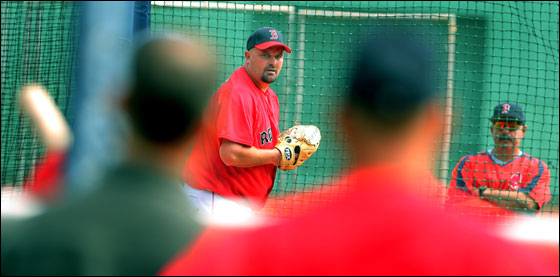 Red Sox pitcher David Wells didn't have much of an audience in the stands as he threw a simulated game this morning at Fenway Park as he tries to get back onto the roster from the disabled list. But he did have some interested observers on the field, as GM Theo Epstein (left from behind, manager Terry Francona (next to Epstein) and interim pitching coach Al Nipper (far right) watched.