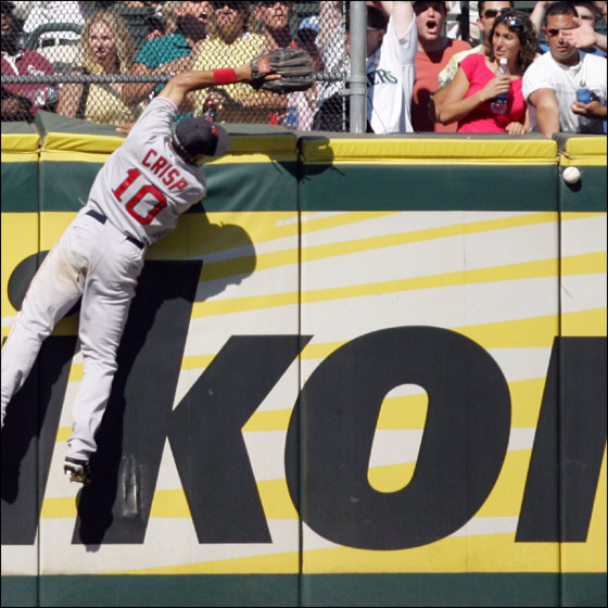 Red Sox center fielder Coco Crisp misses a ball hit Seattle Mariners' Adrian Beltre during the eighth inning of their baseball game in Seattle Sunday, July 23, 2006. Beltre legged out an inside-the-park home run on the play. The Mariners went on to win 9-8.